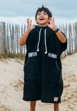 Black kid changing robe